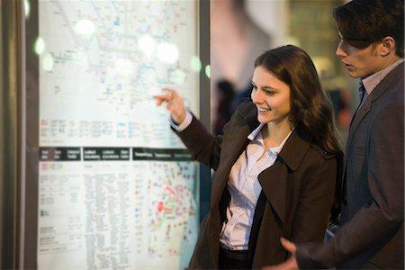 Couple looking at subway map Stock Photo - Premium Royalty-Free, Code: 632-03779669