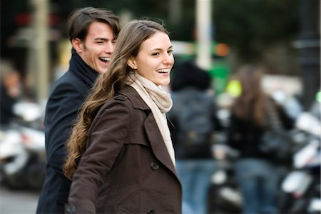 Young couple laughing and walking together outdoors Stock Photo - Premium Royalty-Free, Code: 632-03779699
