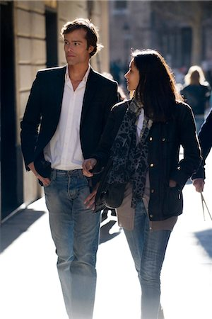 Couple walking together, backlit Stock Photo - Premium Royalty-Free, Code: 632-03779691