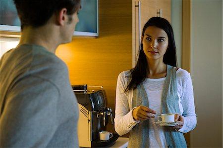 daily - Couple enjoying coffee in kitchen Stock Photo - Premium Royalty-Free, Code: 632-03779749