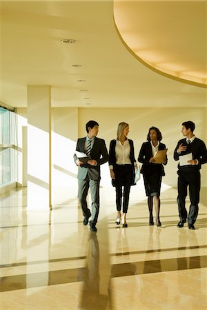 dynamic - Group of executives talking as they walk together in lobby Stock Photo - Premium Royalty-Free, Code: 632-03779778