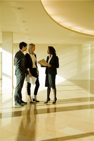 Business executives standing together talking Stock Photo - Premium Royalty-Free, Code: 632-03779792