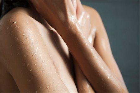 Water droplets on woman's skin Stock Photo - Premium Royalty-Free, Code: 632-03847643
