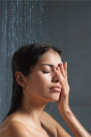 Woman showering Stock Photo - Premium Royalty-Free, Code: 632-03847694