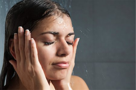 Woman washing face in shower Stock Photo - Premium Royalty-Free, Code: 632-03847709