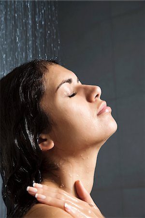 Woman in shower with eyes closed Stock Photo - Premium Royalty-Free, Code: 632-03847717