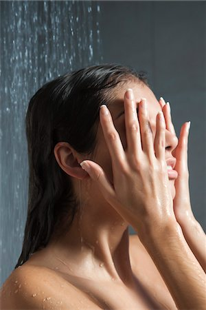Woman washing face in shower Stock Photo - Premium Royalty-Free, Code: 632-03847727