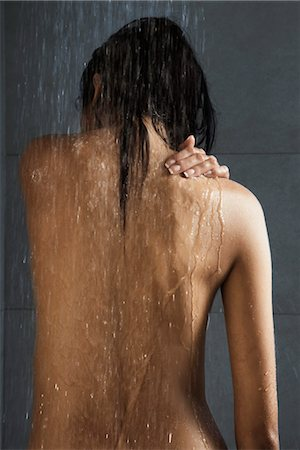 Woman taking a shower, rear view Stock Photo - Premium Royalty-Free, Code: 632-03847738