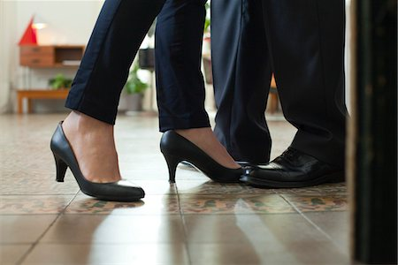 Couple standing face to face, cropped view of feet Stock Photo - Premium Royalty-Free, Code: 632-03847749