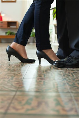 Couple standing face to face, cropped view of feet Stock Photo - Premium Royalty-Free, Code: 632-03847760