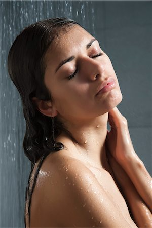 Woman relaxing in shower Stock Photo - Premium Royalty-Free, Code: 632-03847761