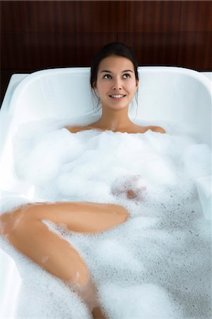 Woman relaxing in bubble bath Stock Photo - Premium Royalty-Free, Code: 632-03847791