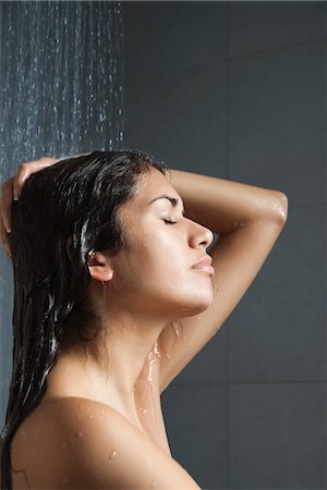 Woman in shower with eyes closed Stock Photo - Premium Royalty-Free, Code: 632-03847803