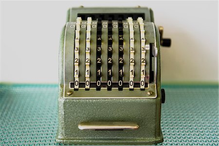 Antique adding machine Stock Photo - Premium Royalty-Free, Code: 632-03847829