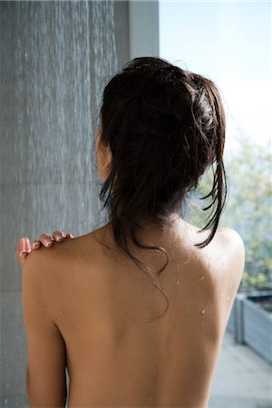 Woman taking a shower, rear view Stock Photo - Premium Royalty-Free, Code: 632-03847879