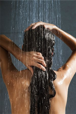 Woman washing her hair in shower Stock Photo - Premium Royalty-Free, Code: 632-03847883