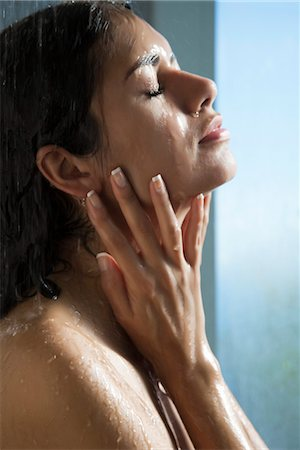 Woman showering Stock Photo - Premium Royalty-Free, Code: 632-03847891