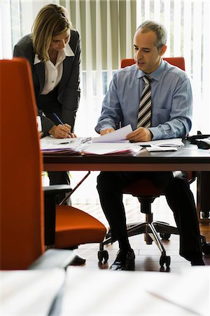secretary desk - Businessman talking to female colleague as she making notes Stock Photo - Premium Royalty-Free, Code: 632-03848024