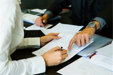 Person signing paperwork, cropped Stock Photo - Premium Royalty-Free, Code: 632-03848027