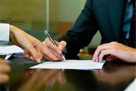 Executive signing paperwork Stock Photo - Premium Royalty-Free, Code: 632-03848036