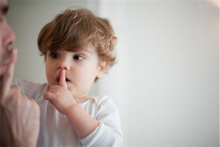 Father hushing toddler boy Stock Photo - Premium Royalty-Free, Code: 632-03848326