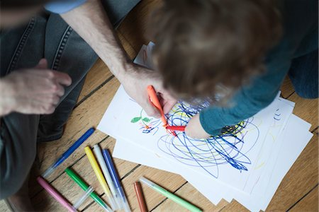 Father and toddler drawing together on paper, high angle view Stock Photo - Premium Royalty-Free, Code: 632-03848360