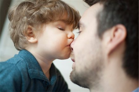 people kissing little boys - Toddler boy kissing father's nose Stock Photo - Premium Royalty-Free, Code: 632-03848361