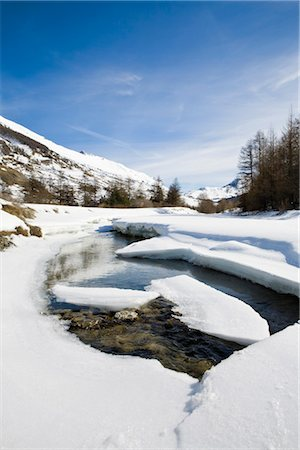 panoramic winter scene - Ice floes floating on river in snowy landscape Stock Photo - Premium Royalty-Free, Code: 632-03897795