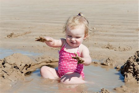 Toddler girl playing at the beach Stock Photo - Premium Royalty-Free, Code: 632-03897892