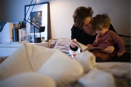 story - Mother holding toddler son on lap, reading bedtime story in bed Stock Photo - Premium Royalty-Free, Code: 632-03897923