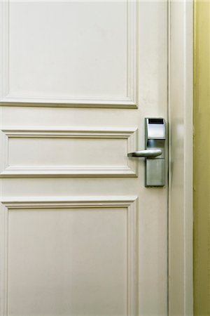 Hotel room door with electronic door lock, full frame Stock Photo - Premium Royalty-Free, Code: 632-03897995