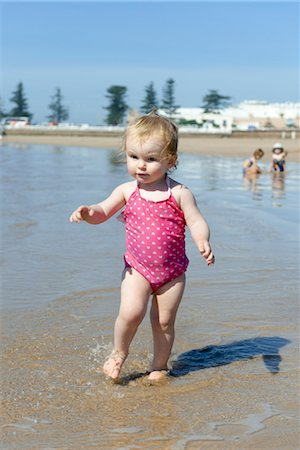 Toddler girl walking in surf at the beach Stock Photo - Premium Royalty-Free, Code: 632-03898184