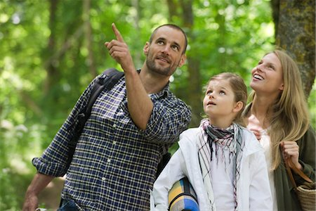 Family together outdoors, looking up in awe Stock Photo - Premium Royalty-Free, Code: 633-05401353