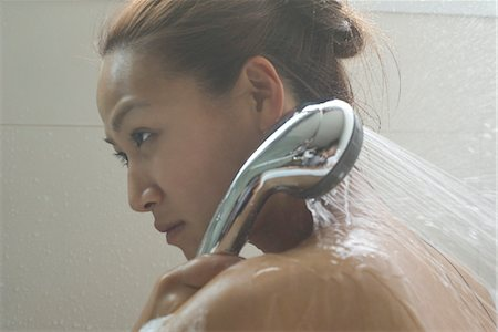 Young woman showering Stock Photo - Premium Royalty-Free, Code: 633-05401440