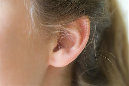 Close-up of young woman's pierced ear Stock Photo - Premium Royalty-Free, Code: 633-05401667
