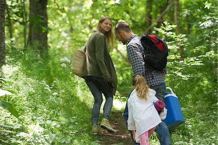 Family hiking in woods Stock Photo - Premium Royalty-Free, Code: 633-05401981