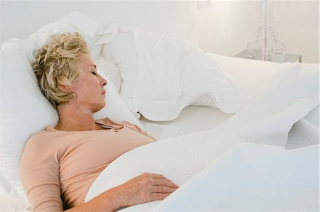 Mature woman sleeping in bed Stock Photo - Premium Royalty-Free, Code: 633-06322228