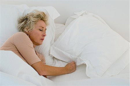 Mature woman sleeping in bed Stock Photo - Premium Royalty-Free, Code: 633-06322387