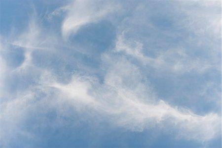 Wispy clouds in sky Stock Photo - Premium Royalty-Free, Code: 633-06322443