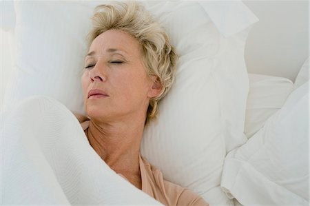 Mature woman sleeping in bed Stock Photo - Premium Royalty-Free, Code: 633-06322687