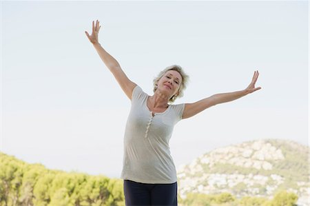 Mature woman exercising with arms outstretched Stock Photo - Premium Royalty-Free, Code: 633-06355055