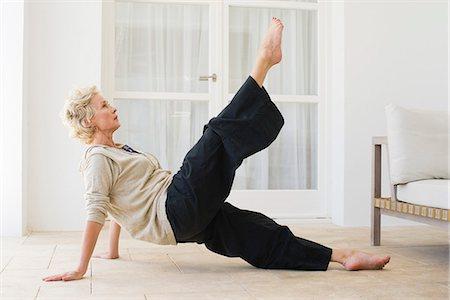 Mature woman practicing pilates Stock Photo - Premium Royalty-Free, Code: 633-06355075