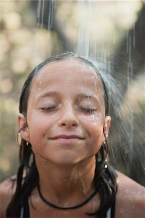 preteens shower - Girl under running water outdoors Stock Photo - Premium Royalty-Free, Code: 633-06355080
