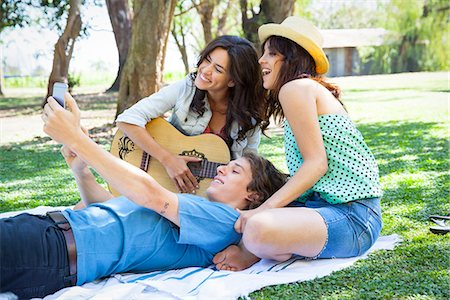 Friends taking selfie in park Stock Photo - Premium Royalty-Free, Code: 633-08639055