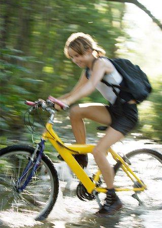 Mountain biker riding through water, motion Stock Photo - Premium Royalty-Free, Code: 633-01274411