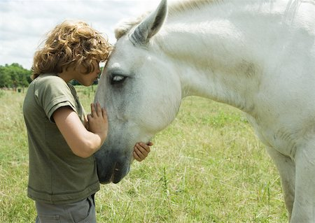 Boy kissing horse Stock Photo - Premium Royalty-Free, Code: 633-01272403