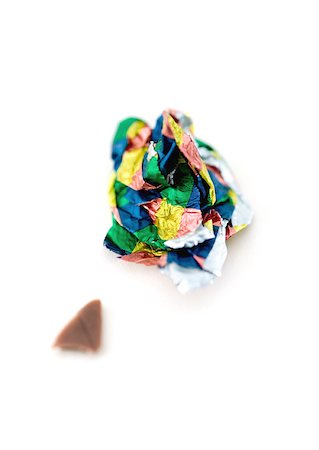 Crumpled candy wrapper and small piece of chocolate Stock Photo - Premium Royalty-Free, Code: 633-01272814