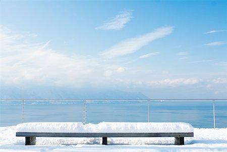 panoramic winter scene - Snow-covered bench overlooking lake Stock Photo - Premium Royalty-Free, Code: 633-01572904