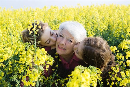 preteen kissing - Senior woman being kissed on cheeks by two granddaughters Stock Photo - Premium Royalty-Free, Code: 633-01715808