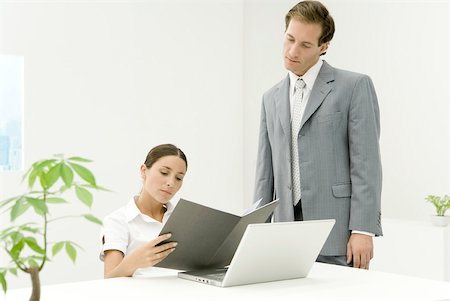 silk floss tree - Professionals in office looking at document together Stock Photo - Premium Royalty-Free, Code: 633-02128811